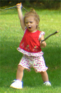 Our granddaughter charging across the yard